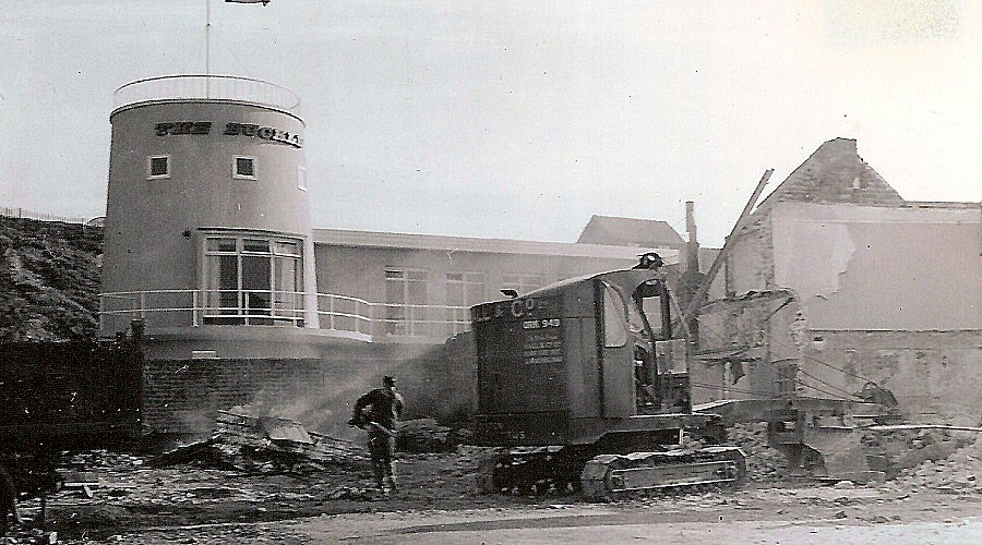The old Buckle Inn being demolished with the new Buckle behind